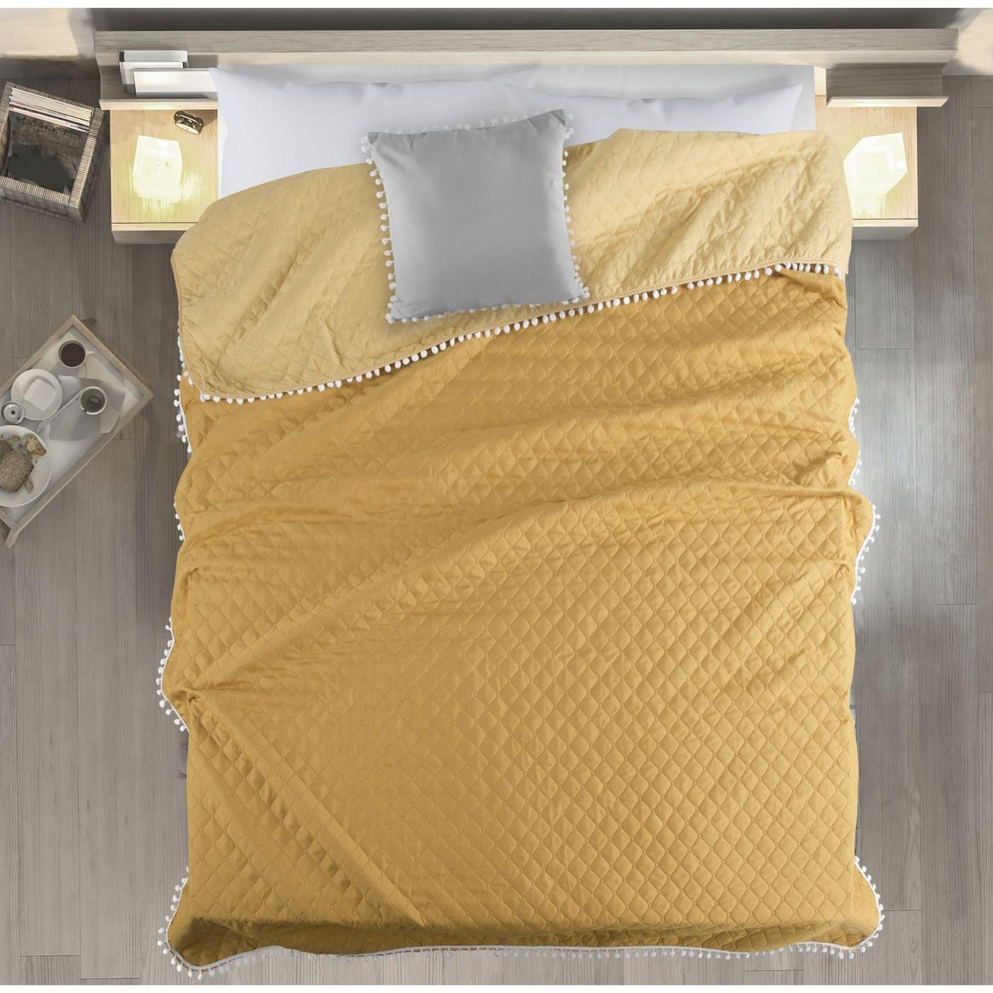 Narzuta zdobiona na brzegach pomponami termozgrzewana żółty 170x210cm
